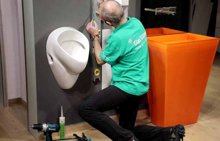 Man Installing A Urinal