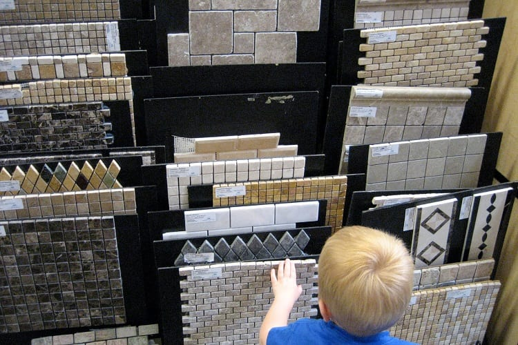 Young Boy Choosing Tiles